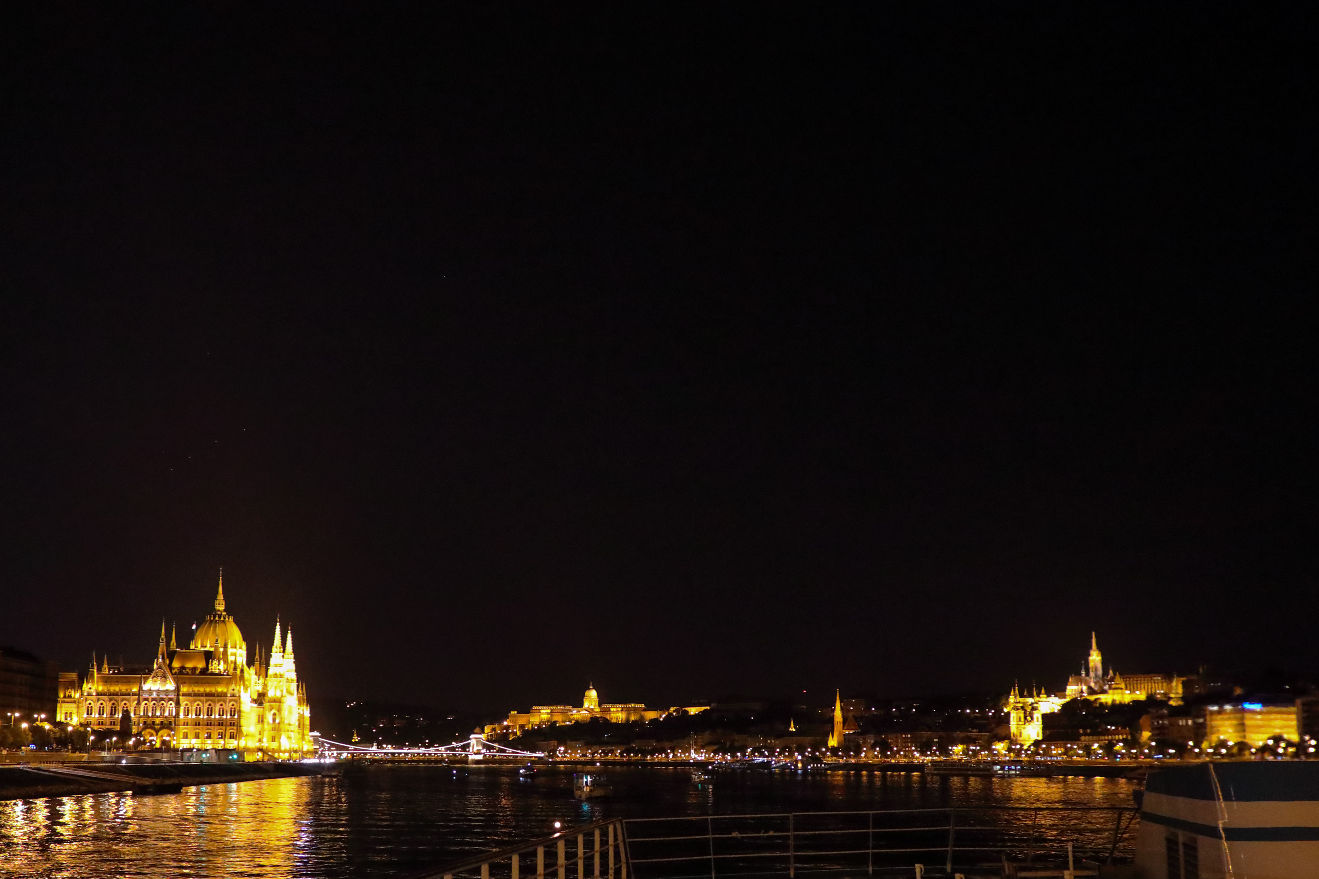 574B7070_c.jpg - Sail away from  Budapest . To the left is the  Hungarian Parliament Building , to the right is the  Matthias Church  with the  Fisherman's Bastion  and in the center above the  Danube  is  Buda Castle